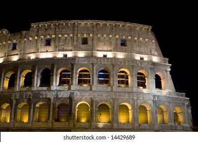 Antique colosseum at night in Rome with lights