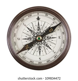 Antique compass in a brass case on  white background