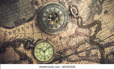 Antique pocket watch imgenes pagas y sin cargo y vectores en stock antique compass necklace and pocket watch pendant on old world map gumiabroncs Image collections