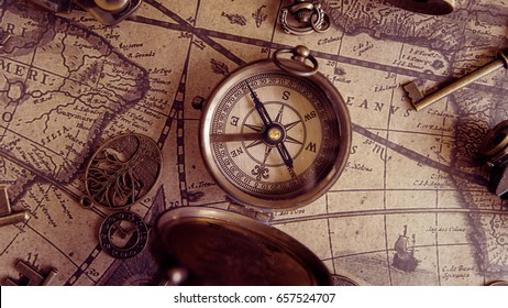 Antique Compass On Ancient World Map