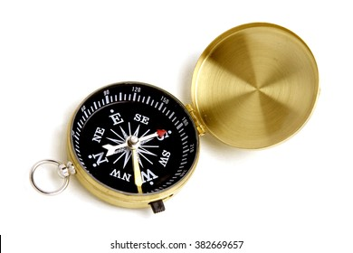 Antique compass on white background