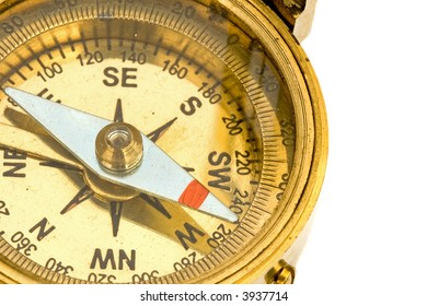 Antique compass used by explorers for finding directions and reading a map or chart