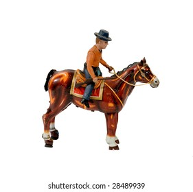 ANTIQUE COWBOY WITH HORSE WIND-UP TIN TOY