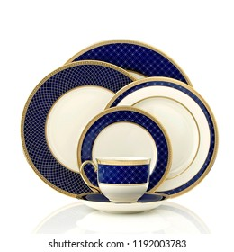 antique creamy ivory tea cup set. luxury ceramic golden kettle set on white background, golden tea cup and dish
