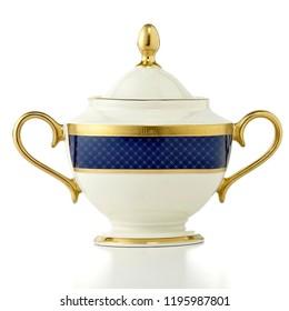 antique creamy ivory teapot. luxury ceramic golden kettle on white background, golden teapot