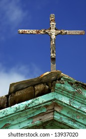 antique cross on the old roof