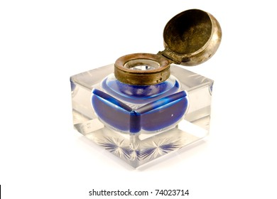 Antique crystal  inkwell with blue ink isolated on white