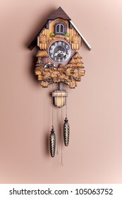 an antique cuckoo clock hanging on the wall