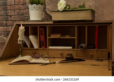 Antique desk with his pen and old books