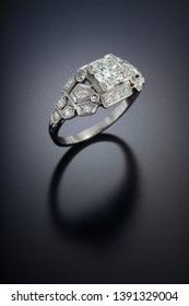 Antique diamond engagement ring with a one carat plus center stone and accent side diamonds set in platinum.