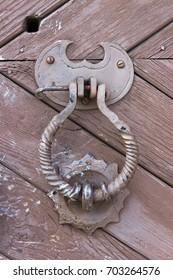 The antique door with beaten handle