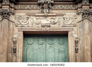 Antique door decoration detail. Italian renaissance door frame. Embelished entrance. Flourish motif.