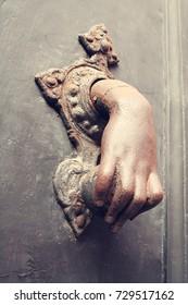 Antique door knobs. Street of Bologna, Italy