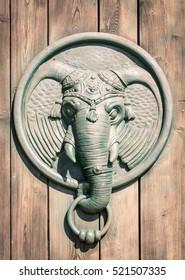 Antique door knocker shaped like elephant's head.