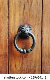 antique door knocker, wood door