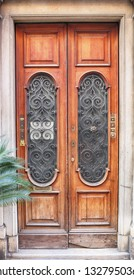 antique door with window and wrought iron grille