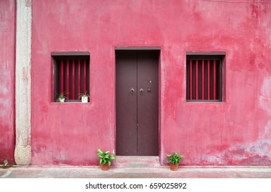 Antique door and windows with red wall at Kaiyuan temple at Chaozhou town, Guangdong, China.