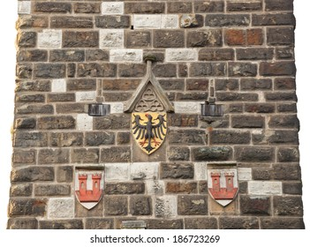 Antique eagles emblem on the wall of old tower in Rothenburg od der Tauber.