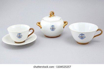 Antique english golden tea cup isolated over white