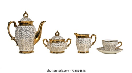 Antique english golden tea set isolated over white