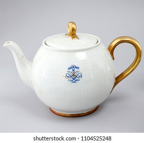 Antique english golden teapot isolated over white
