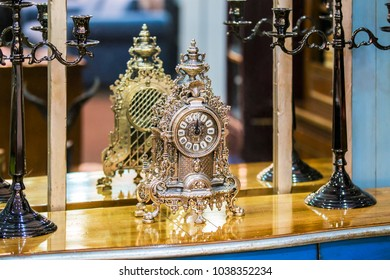 Antique expensive silver old clock on the chest of drawers.