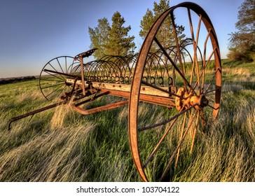 Antique Farm Equipment sunset Saskatchewan Canada