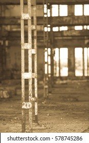 Antique filtered Interior view of dark dirty old abandoned vandalised factory ruin, deserted hall, rusty steel structure, graffiti wall, copy space.