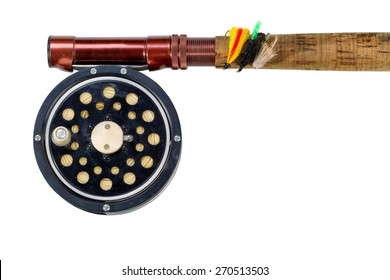 Antique fly fishing reel, flies and rod isolated on white background.