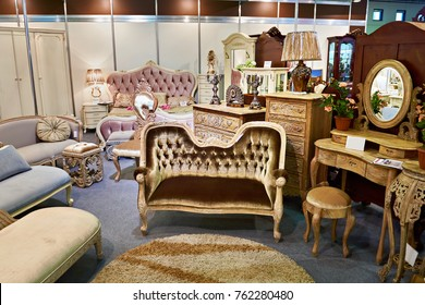 Antique furniture store with sofa and commode