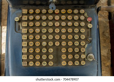 Antique Gas Station Cash Register Keys covered in dust and dirt