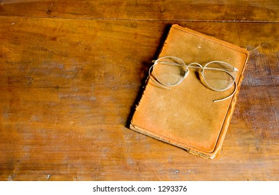 Antique Glasses and Leather Book - Copy Space