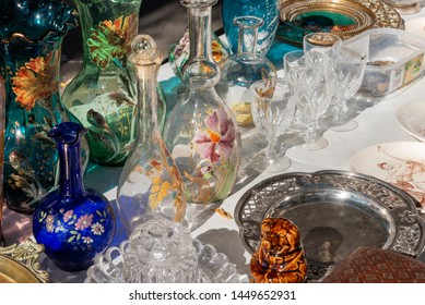 Antique glasses and plates for sale at a provencal flea market