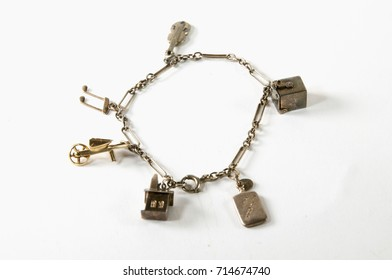 Antique gold charm bracelet with musical charms