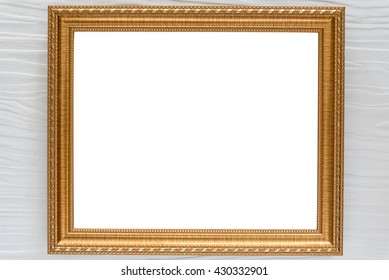 The antique gold frame on the wall white