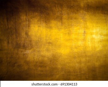 Antique golden grunge background with highlight and blur the edges