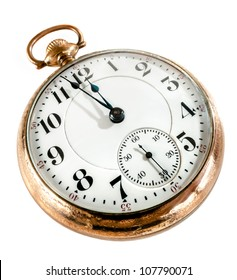 Antique golden pocket watch showing a few minutes to midnight isolated on white background. Concept of time,the past or deadline.
