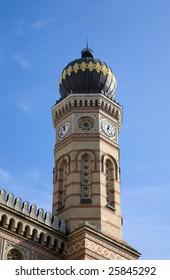 Antique golden synagogue in Budapest over blue sky