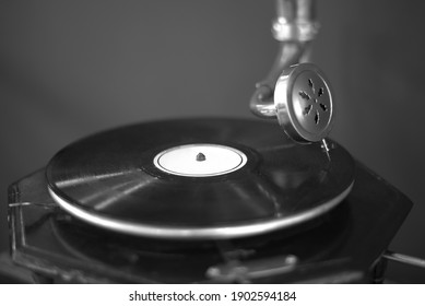 Antique gramophone. Close-up, vintage record player, While playing the record, Black platter.