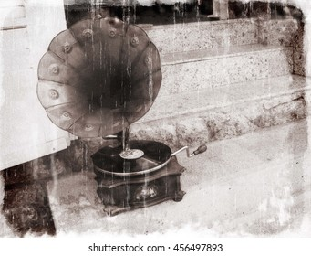Antique gramophone on the stairs of a house (in black and white, vintage style with special vintage effects)