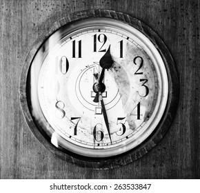 Antique grandfather clock, black and white photo, close up photo