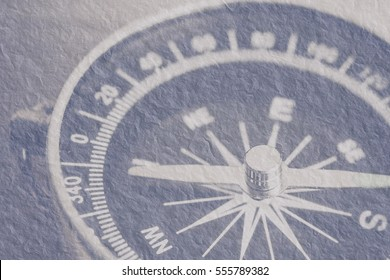 Antique grunge compass with needle pointing the North and South direction for background. Illustration on textured vintage paper.
