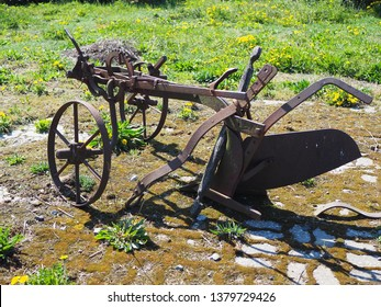 Antique horse drawn plow. One bottom plow with wheels that would have been pulled by a horse to break up the ground.