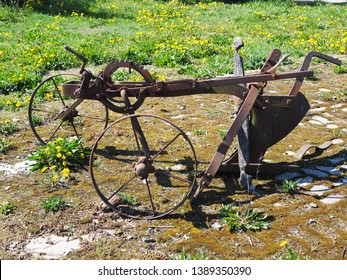 Antique horse drawn plow. One bottom plow with wheels that would have been pulled by a horse to break up the ground. Technology of plow
