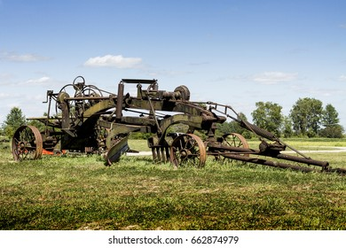 Antique horse drawn two man road grader