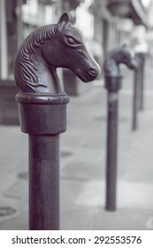 Antique horse head hitching post in the New Orleans French Quarter with shallow depth of field and retro filter effect