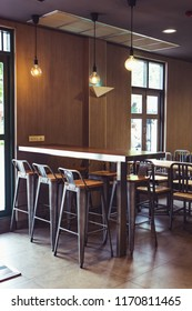 Antique Industrial vintage metal high bar chairs and wooden table in coffee shop
