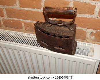 Antique iron in the interior for ironing clothes