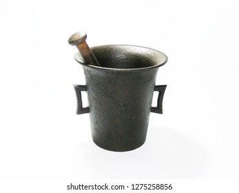 Antique iron mortar and pestle for making spices with white background