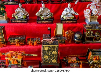 Antique Japanese dolls dressed in colorful kimonos represent an ancient royal court during the annual Japan Dolls Festival ('Hinamatsuri').